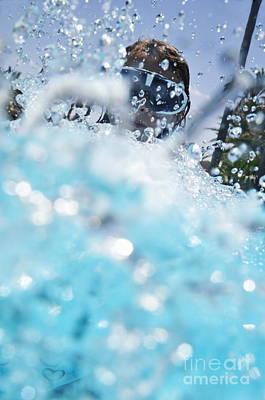 Girl Splashing Water In Swimming Pool Print by Sami Sarkis