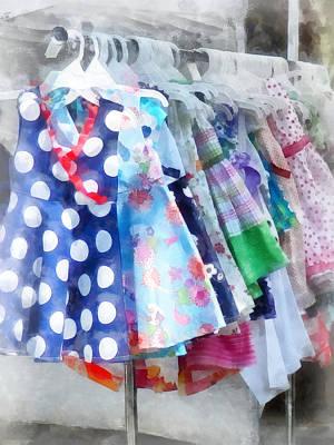 Girl's Dresses At Street Fair Print by Susan Savad