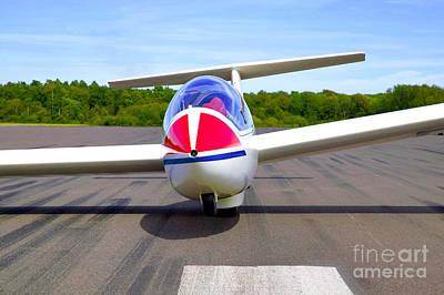 Glider On A Runway Print by Richard Thomas