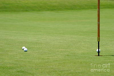 Golf Balls Near Flagstick Print by Henrik Lehnerer
