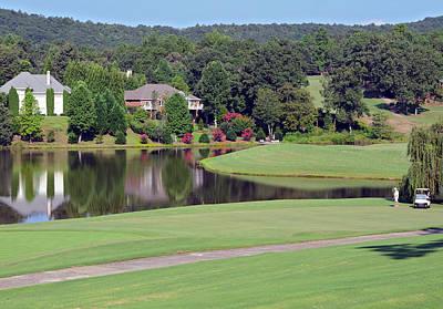 Golfer At Lake  Print by Susan Leggett