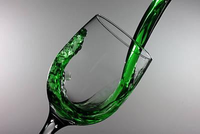 Green Juice Splashing From A Wine Glass Print by Paul Ge