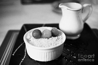Home Made Apple Crumble Dessert With Grapes Served In A Gastro Pub Scotland Uk Print by Joe Fox