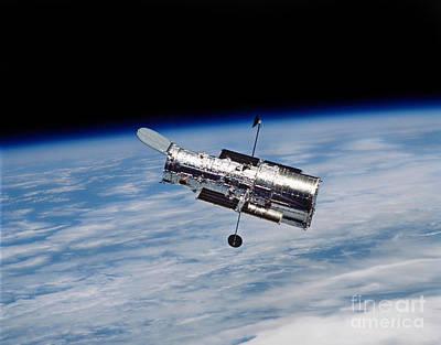 Hubble Space Telescope Views Photograph - Hubble Space Telescope In Orbit by Stocktrek Images