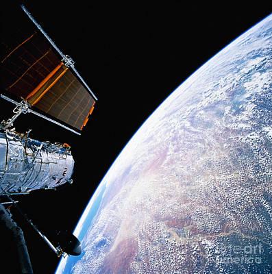 Hubble Space Telescope Views Photograph - Hubble Space Telescope by Stocktrek Images