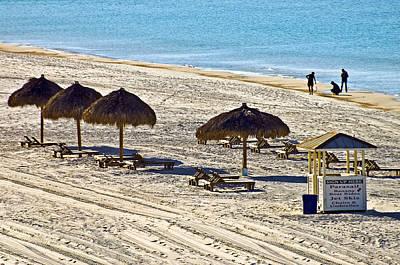 Huts On The Beach Print by Susan Leggett