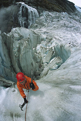 Ice Climber On Steep Ice In Fox Glacier Print by Colin Monteath
