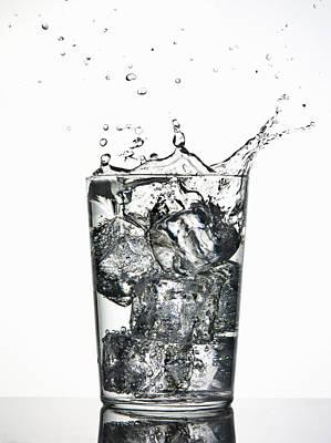 Ice Cubes Splashing Into Fizzy Drink Print by Walter Zerla