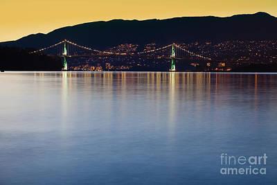 Illuminated Bridge Across A Bay Print by Bryan Mullennix