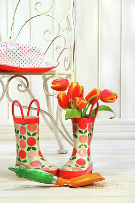 Iron Chair With Little Rain Boots And Tulips  Print by Sandra Cunningham