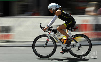 Triathlon Photograph - Ironman 2012 Flying By by Bob Christopher