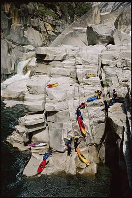 Transportation Of Goods Photograph - Kayakers Portaging Unrunnable Waterfall by Skip Brown