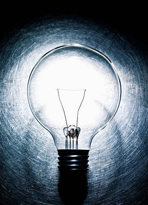 New Generations Photograph - Light Bulb On Stainless Steel Background. by Ballyscanlon