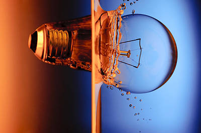 Light Bulb Shot Into Water Print by Setsiri Silapasuwanchai