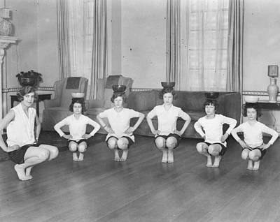 Line Of Girls (7-12) Exercising With Bowls On Heads (b&w) Print by Hulton Archive