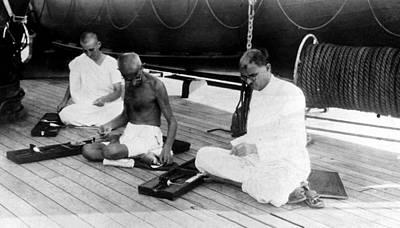 Mahatma Gandhi Photograph - Mahatma Gandhi Weaves Cloth Aboard by Everett