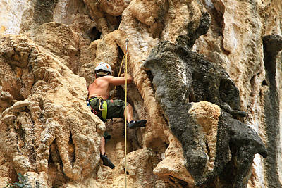 Laos Photograph - Man Climbing Rock by Ulrike Maier