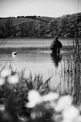 Man Flyfishing In A Lake In Ireland Print by Joe Fox