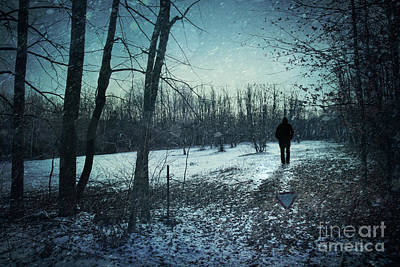 Man Walking In Snow At Winter Twilight Print by Sandra Cunningham