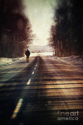 Man Walking On A Rural Winter Road Print by Sandra Cunningham