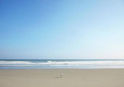 Man Walking On Beach Print by Thomas Northcut