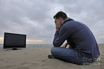 Man With Tv On Beach At Sunset Print by Sami Sarkis
