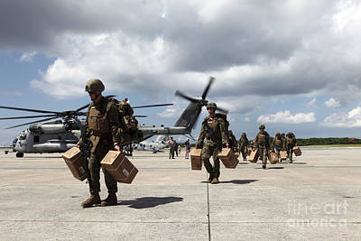 Japan Relief Photograph - Marines Carry Supplies To A Hangar by Stocktrek Images