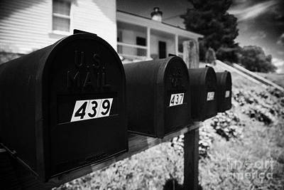 matt black american private mailboxes in front of houses Lynchburg tennessee usa Print by Joe Fox