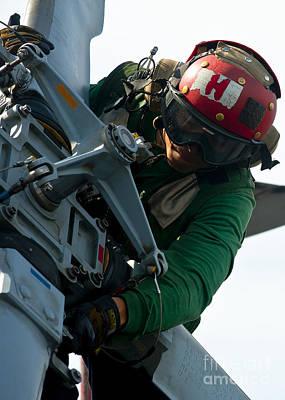 Seahawks Glass Photograph - Mechanic Inspects An Mh-60r Sea Hawk by Stocktrek Images