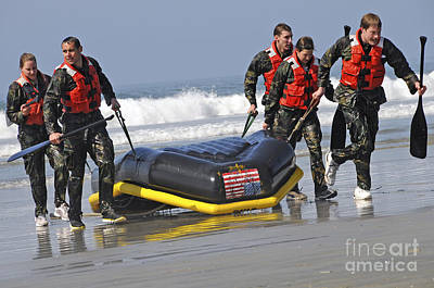 Rigid Hull Inflatable Boats Photograph - Members Of The Us National Swim Team by Stocktrek Images