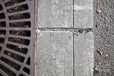 Metal Grate On Sidewalk Print by Paul Edmondson
