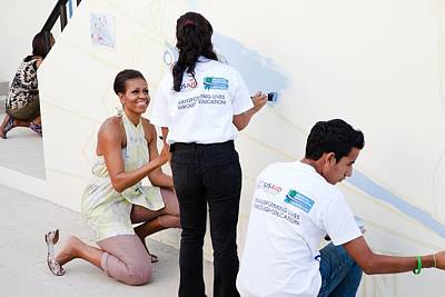 Michelle Obama Photograph - Michelle Obama Helps Paint A Mural by Everett