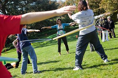 Michelle Obama Photograph - Michelle Obama Hula Hoops With Children by Everett