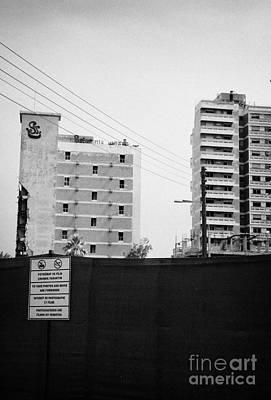 No Photography Warning Signs At Varosha Forbidden Zone With Salaminia Tower Hotel Abandoned In 1974 Print by Joe Fox