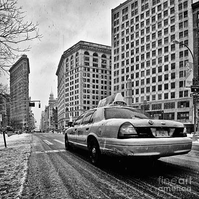 Nyc Cab And Flat Iron Building Black And White Print by John Farnan