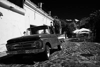 old ford pickup truck on historic paved spanish street Barrio Historico Colonia Del Sacramento Print by Joe Fox