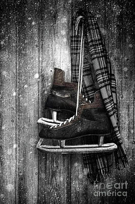 Old Ice Skates Hanging On Barn Wall Print by Sandra Cunningham