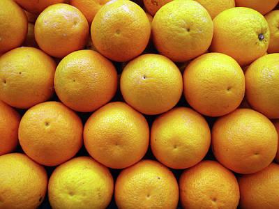 Orange Fruits Pile At Fruit Market Print by Suchitra Prints