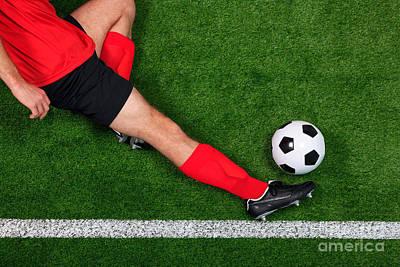 Overhead Football Player Sliding Print by Richard Thomas