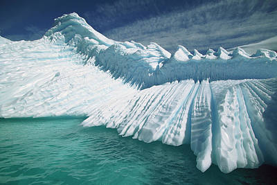 Overturned Iceberg With Eroded Edges Print by Colin Monteath