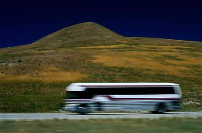 Panned View Of A Bus On Interstate 15 Print by Raymond Gehman