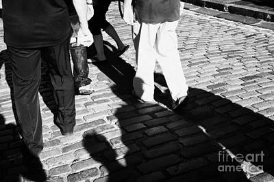 People Walking Along The Cobbled Streets Of Castle Hill Edinburgh Scotland Uk United Kingdom Print by Joe Fox