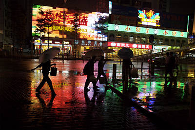 People Walking In Shenzhen On A Rainy Print by Randy Olson