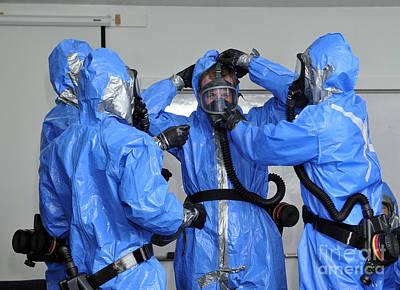 Personnel Dressed In Hazmat Suits Print by Stocktrek Images