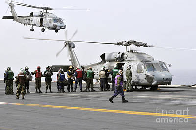 Japan Relief Photograph - Personnel Load Humanitarian Supplies by Stocktrek Images
