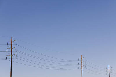 Telephone Poles Photograph - Power Lines Against A Clear Sky by Patrick Strattner