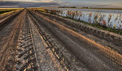 Prairie Road Storm Clouds Mud Tracks Print by Mark Duffy