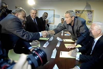 President George W. Bush Shakes Hands Print by Everett