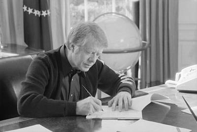 Carter House Photograph - President Jimmy Carter Working by Everett