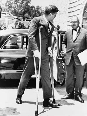 President John F. Kennedy On Crutches Print by Everett